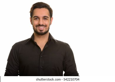 Young happy Indian man smiling isolated against white background