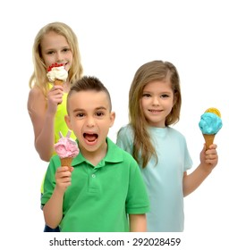 Young happy kids girls and boy ready eating red green blue raspberry vanilla ice cream in waffles cones smiling yelling isolated on a white background