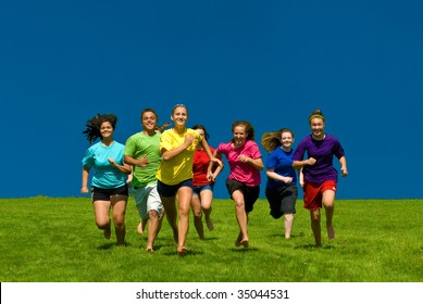 Young happy kids running under blue sky