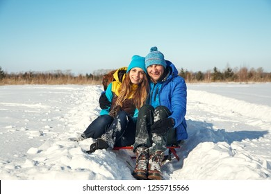 Young happy kissing couple in love in the winter outdoors