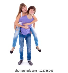Young Happy Laughing Couple In Love isolated on a white