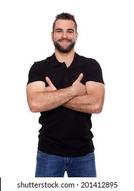 Young happy man with crossed hands in a black polo shirt on white background