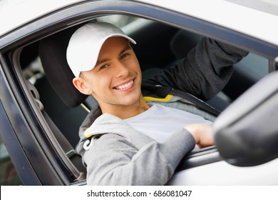 young happy man driving a car