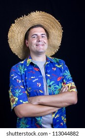 young happy man with a hawaiian shirt on black background