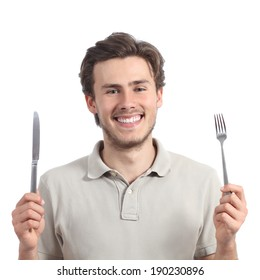 Young happy man holding a fork and a knife isolated on a white background