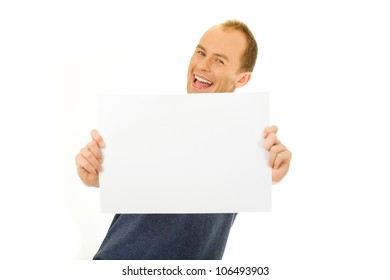 Young happy man holding a white board, isolated on white background