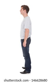 Young Happy Man Standing Over White Background