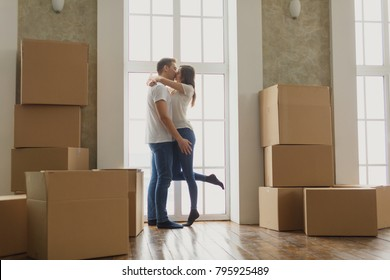 Young happy millennial couple students move into their first new owners home. Simple white background of urban apartment