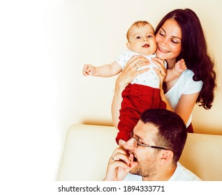 young happy modern family smiling together at home. lifestyle people concept, mother, father and little son