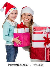 Young and happy mother and daughter in Christmas hats, isolated on white background