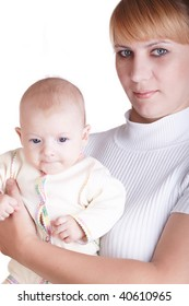 Young happy mother hugging baby on the white background
