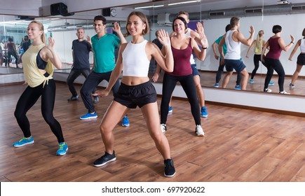 Young happy people dancing  in dancing class