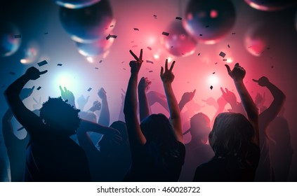 Young happy people are dancing in club. Nightlife and disco concept. - Shutterstock ID 460028722