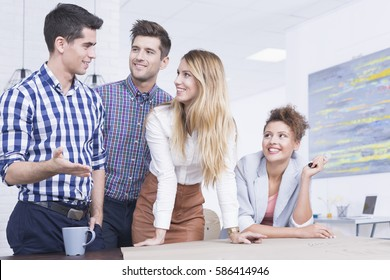 Young happy people having modern business together