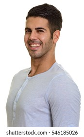 Young happy Persian man smiling isolated against white background