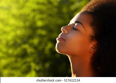 young happy and  pretty afro wooman closeup portrait on natural background