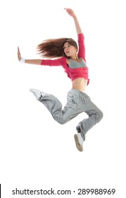 Young happy pretty modern slim hip-hop style woman dancer dancing jumping isolated on a white studio background