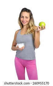 young happy sexy blond hair woman with fit slim body smiling and holding green apple fruit and cream yogurt in her hand in bio and healthy nutrition, fitness and diet concept