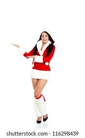 young happy smile woman wear Santa Clause costume hold open palm pointing to side empty copy space attractive christmas new year party girl, full length portrait isolated over white background