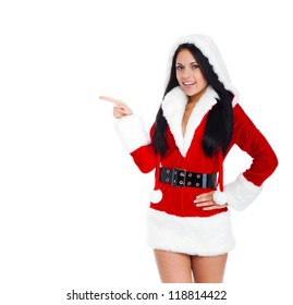 young happy smile woman wear Santa Clause costume hold pointing her finger to side empty copy space attractive christmas new year party girl, isolated over white background
