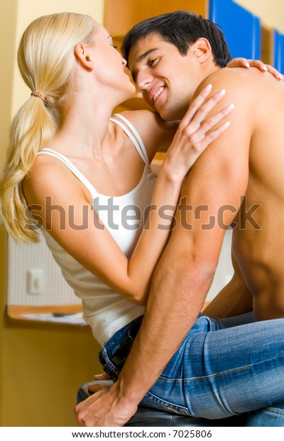 Young happy smiling amorous couple embracing at home