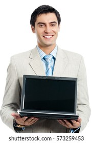 Young happy smiling businessman with laptop, isolated on white background. Business success concept.