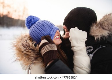 Young  happy smiling couple in love. Having fun. Winter