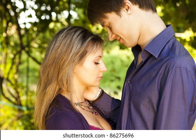 young happy smiling couple in love outside