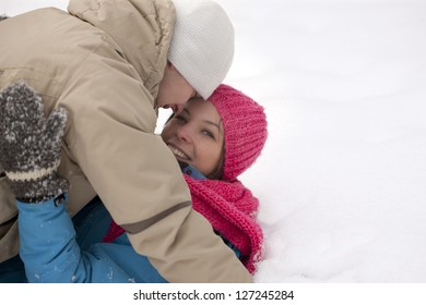 Young happy smiling couple on the snow