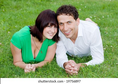 Young, happy and smiling couple in a park.