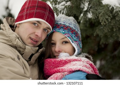 Young happy smiling couple in winter