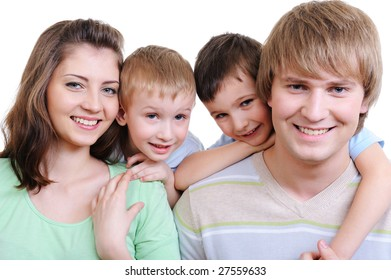 young happy smiling family on close-up portrait on white background