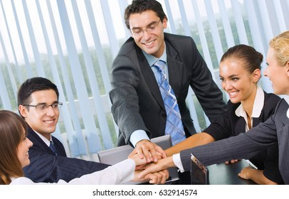Young happy smiling successful businesspeople at meeting, presentation or conference. Success in business and teamwork concept.