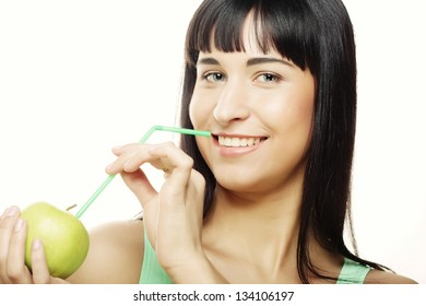 Young happy smiling woman with apple and Straws Cocktail