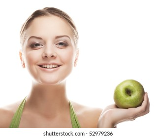 Young happy smiling woman with apple, isolated on white