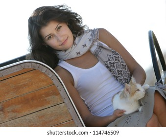 young happy smiling woman with cat on natural background
