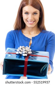 Young happy smiling woman with gift, isolated on white background
