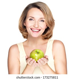 Young happy smiling woman with green apple - isolated on white.