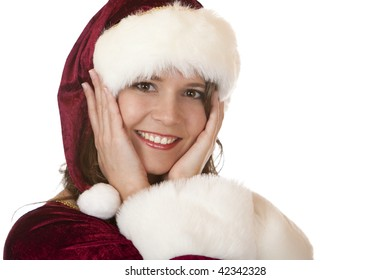 Young, happy and smiling woman is holding her cheeks with hands. Isolated on white.