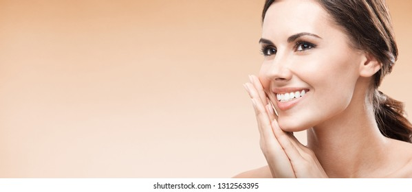 Young happy smiling woman, on color background, with blank copy space area for advertising slogan or text message. Caucasian female model in beauty, healthcare, skincare, face, dental health concept.