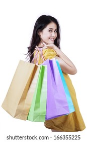 Young happy smiling woman with shopping bags, isolated on white background