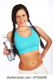 young happy sporty woman with mineral water