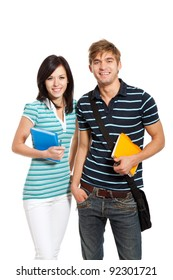 Young happy students couple smiling, holding notebooks, looking at camera, isolated over white background