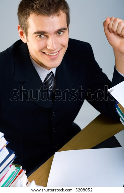 Young happy successful business man or student