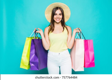 Young happy summer shopping woman with shopping bags isolated