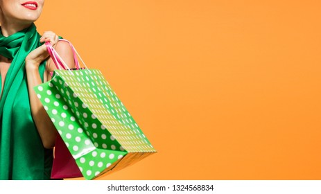 Young happy summer or spring shopping woman with shopping bags