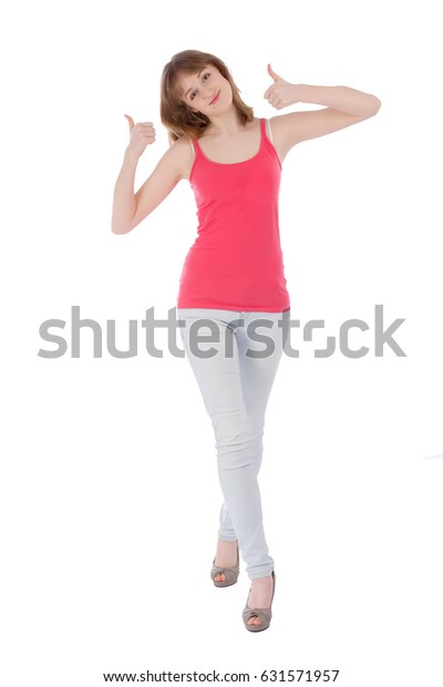 Young happy teenager showing thumbs up over white background