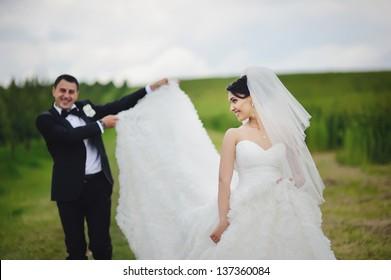young happy wedding couple having fun