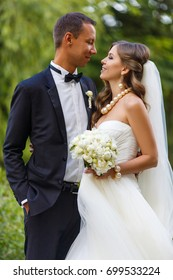 Young happy wedding couple hugging in nature