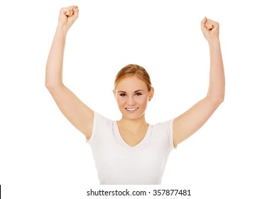 Young happy woman with arms up.